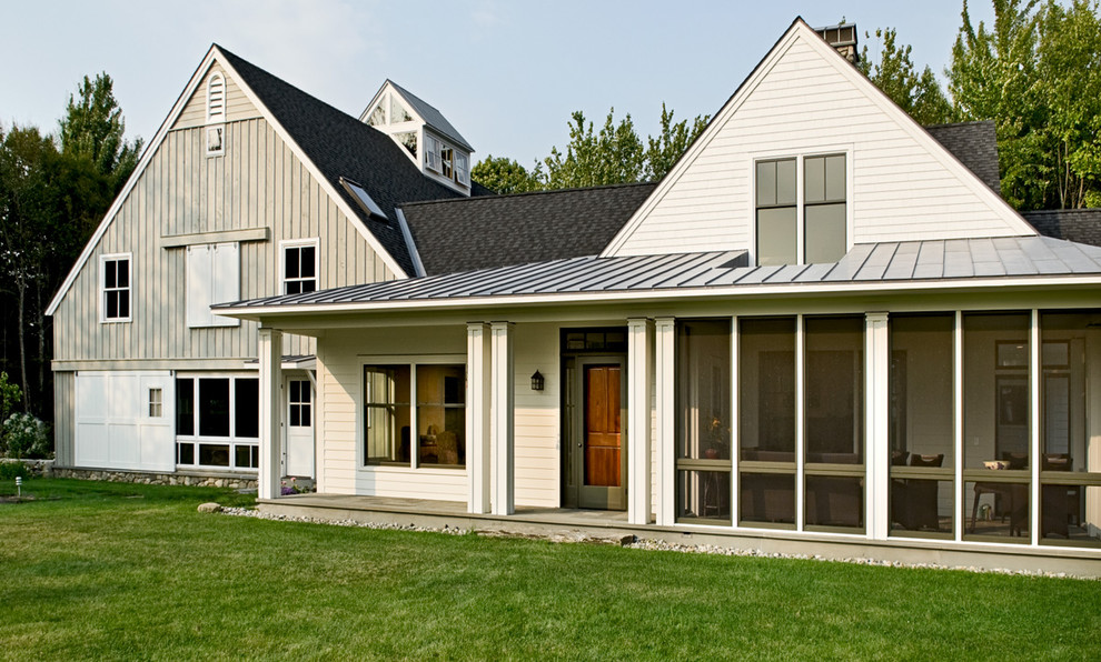 Mid-sized cottage two-story wood exterior home photo in Portland Maine with a mixed material roof