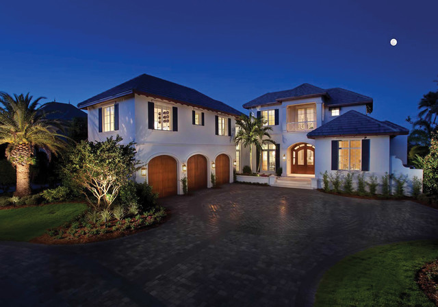 Example of an island style two-story exterior home design in Miami with a hip roof