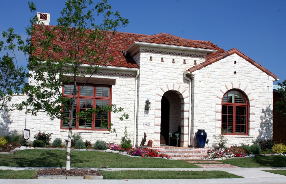 Mid-sized tuscan white one-story stone exterior home photo in Dallas