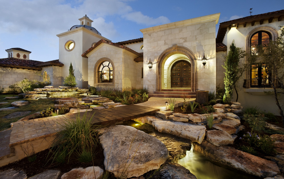 Example of a tuscan one-story exterior home design in Austin