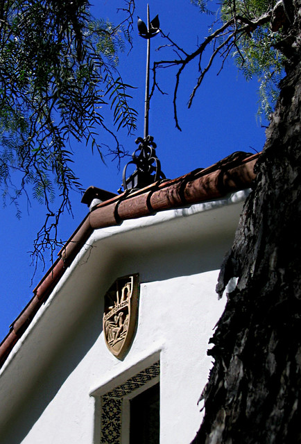 Spanish Roof Finial And Family Crest Mediterranean Exterior