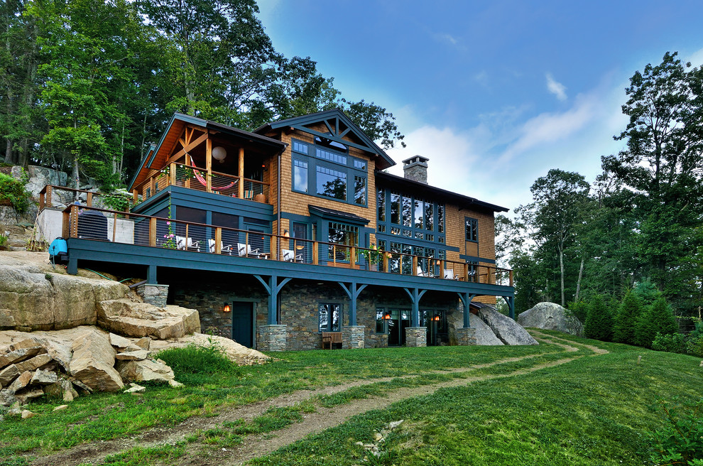 Inspiration for a large rustic three-story wood exterior home remodel in New York