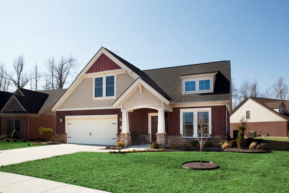 Example of a mid-sized arts and crafts red two-story mixed siding exterior home design in Other