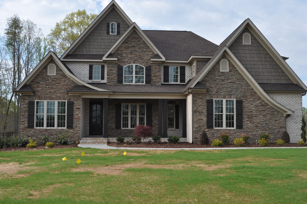 Transitional beige brick exterior home idea in Raleigh