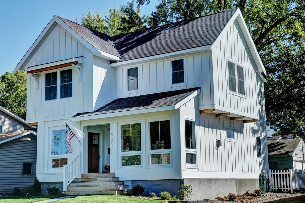 Example of a country exterior home design in Minneapolis