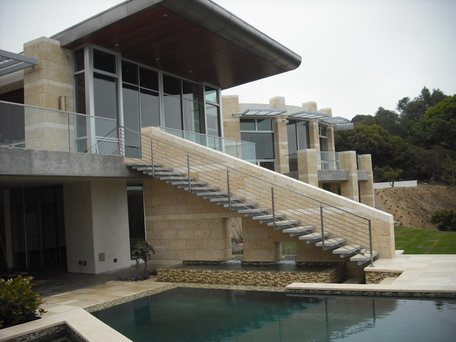 Stainless and glass exterior contemporary exterior for Modern house exterior stairs