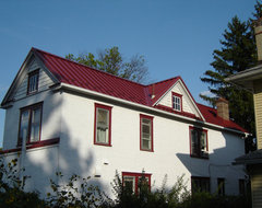 Standing Seam Metal Roofing in Colonial Red traditional-exterior