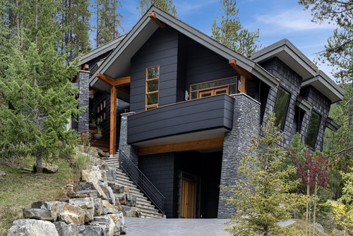 Dark black house with wood trim