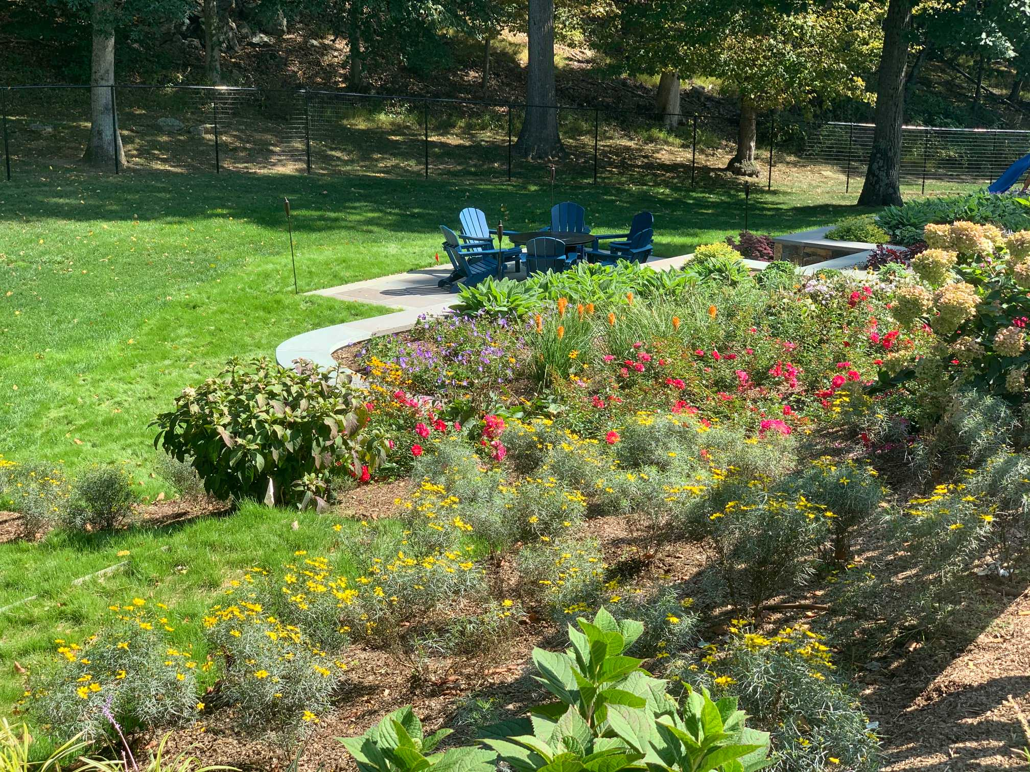 Steep Slope Perennial Garden with Retaining wall and Patio