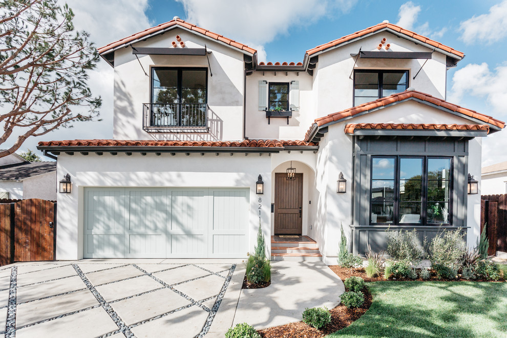 Inspiration for a mediterranean white two-story exterior home remodel in Los Angeles with a tile roof