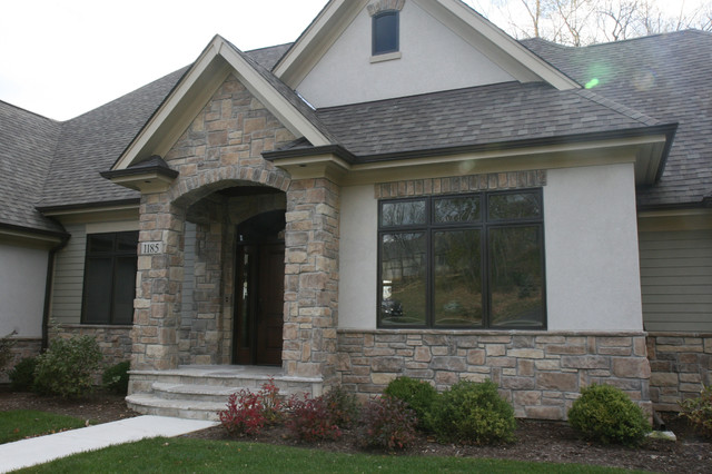 Stone and stucco exteriors traditional exterior for Stucco homes with stone accents