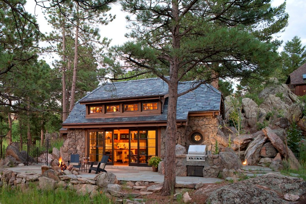 Small rustic brown one-story stone house exterior idea in Denver with a shingle roof and a hip roof
