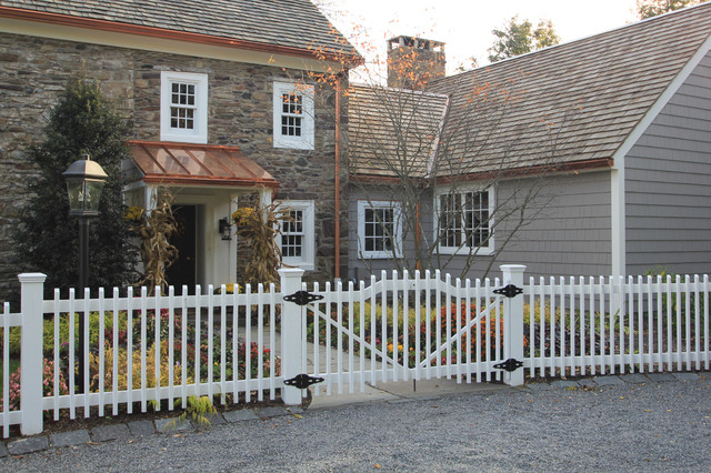 Inspiration For A Large Farmhouse Gray Two Story Stone Exterior Home Remodel In New York