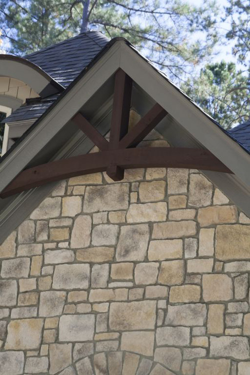 Love these gable pediments and brackets on the porch posts for Exterior pediments