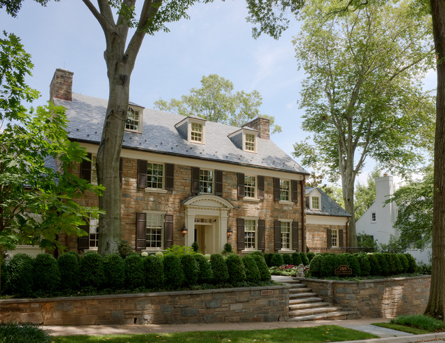 Example of a large classic three-story stone gable roof design in DC Metro