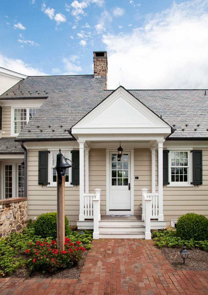 Cottage beige one-story exterior home photo in Philadelphia