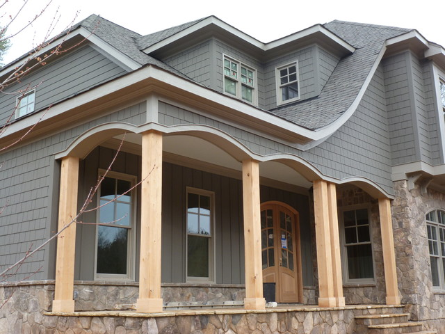 Stone shake arches columns board and batten traditional exterior raleigh by built Exterior board and batten spacing