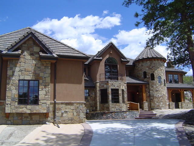 Stone stone stone stucco traditional exterior for Exterior by design stucco stone