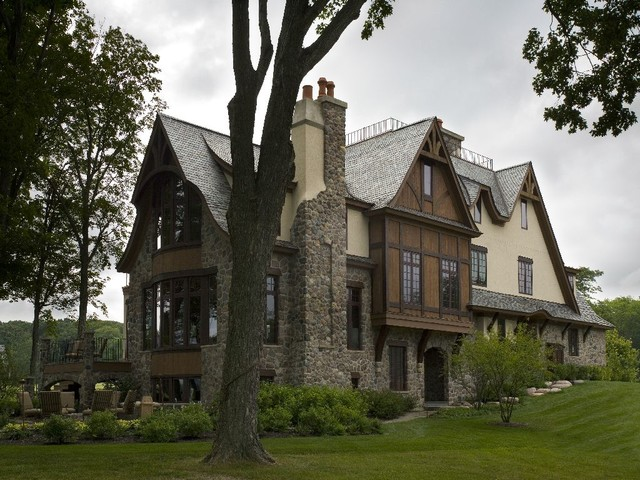Stone Stucco And Cedar Chateau With Clay Chimney Pots And