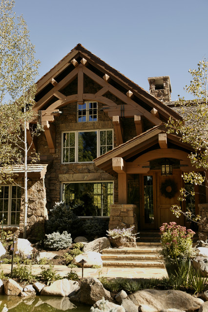 Storm mountain ranch house rustic exterior denver by paddle creek design Rustic home architecture