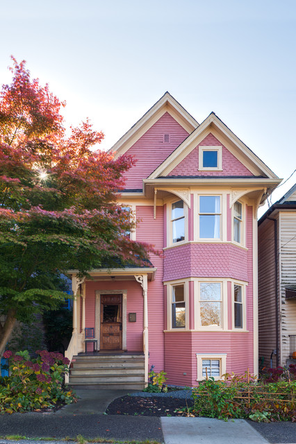 Inspiration for a classic two floor exterior in Vancouver with a pink house.