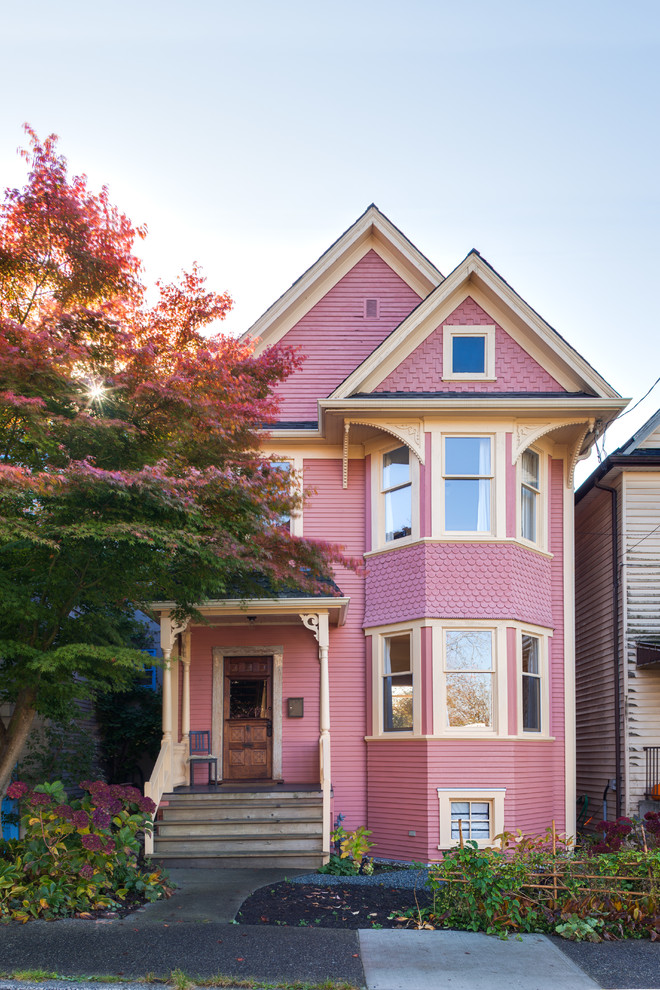Elegant pink two-story exterior home photo in Vancouver