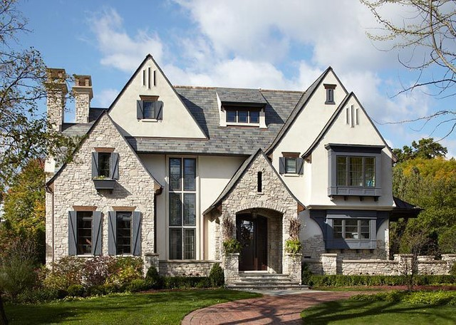 Stucco stone traditional exterior chicago by for Stucco stone exterior designs