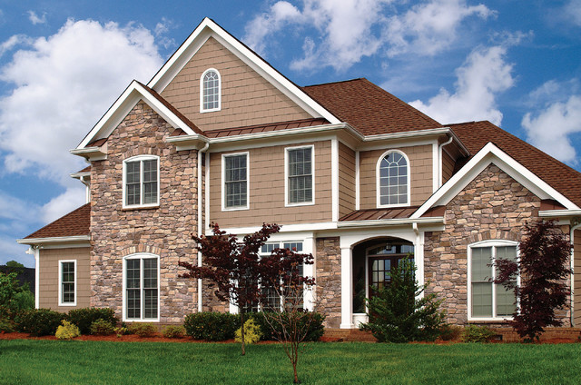 Stunning home featuring french country stone siding Stone products for home exterior