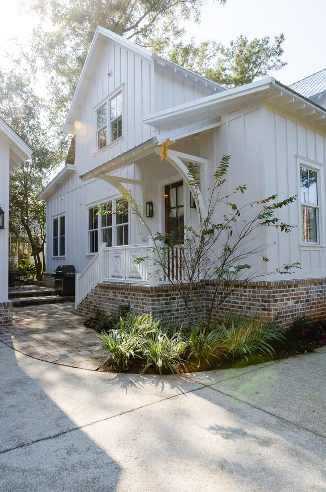Farmhouse exterior home idea in Other