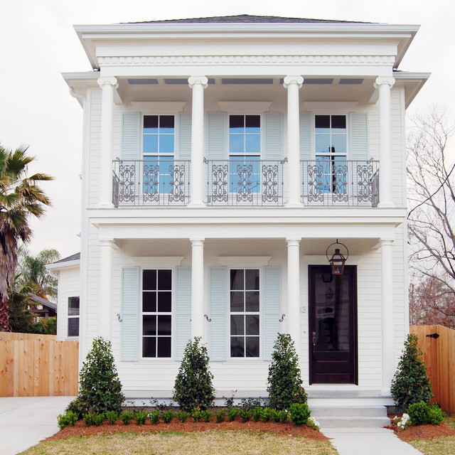 Inspiration for a timeless white two-story wood exterior home remodel in New Orleans with a hip roof