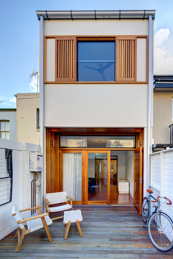 Inspiration for a modern beige two-story exterior home remodel in Sydney