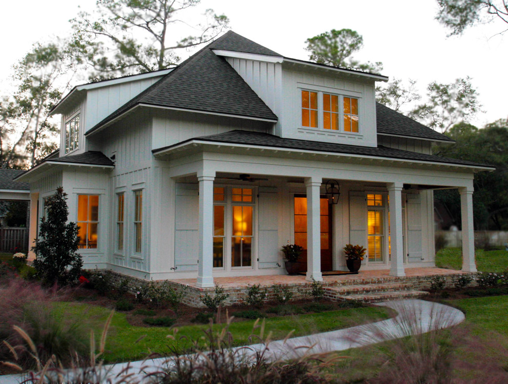 Mid-sized arts and crafts white two-story wood exterior home photo in Other with a clipped gable roof