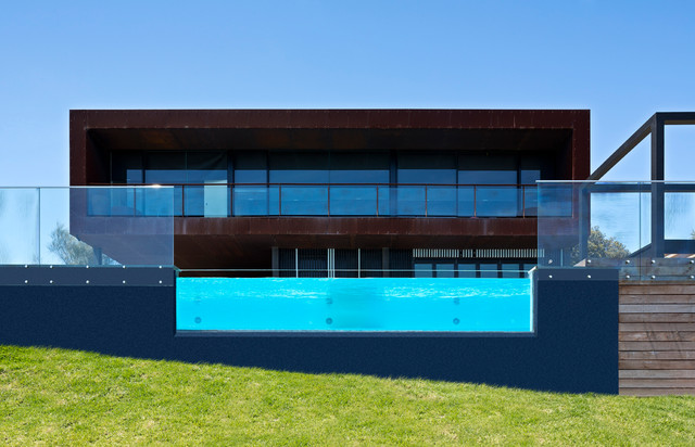 Inspiration for a large contemporary two-storey exterior in Melbourne with metal siding.