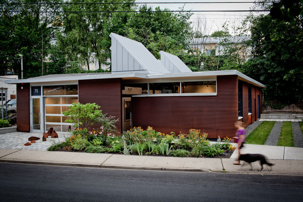 Inspiration for an industrial one-story metal exterior home remodel in New York