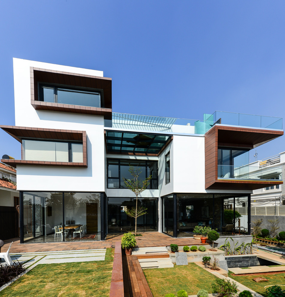 Example of a large trendy multicolored three-story exterior home design in Hyderabad