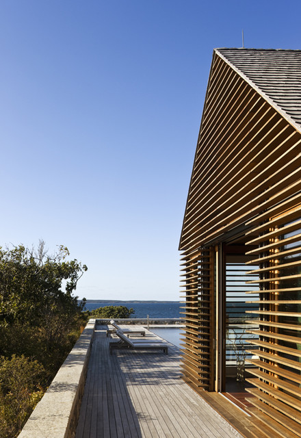 Teak Louvers on Poolhouse beach-style-exterior