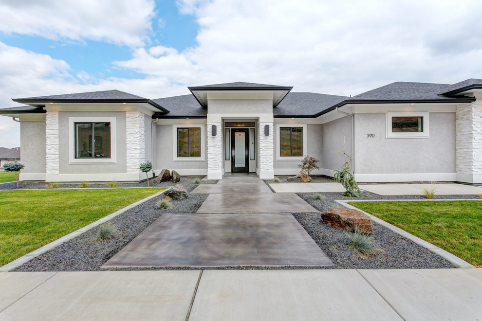 Mid-sized transitional gray one-story stucco house exterior photo in Seattle with a hip roof and a shingle roof