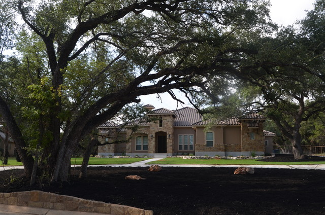 Texas hill country stone and stucco home for Texas hill country stone homes