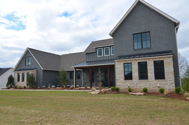 Example of an island style exterior home design in Other