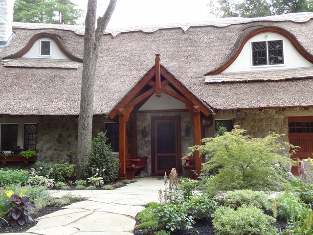 Thatched Roof Home in MA Featuring Boston Blend Round Thin Veneer Siding eclectic-exterior
