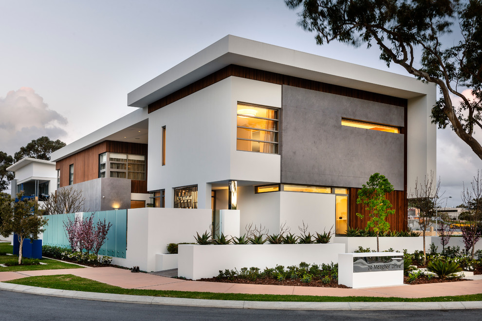 Contemporary two-storey white exterior in Perth with mixed siding and a flat roof.