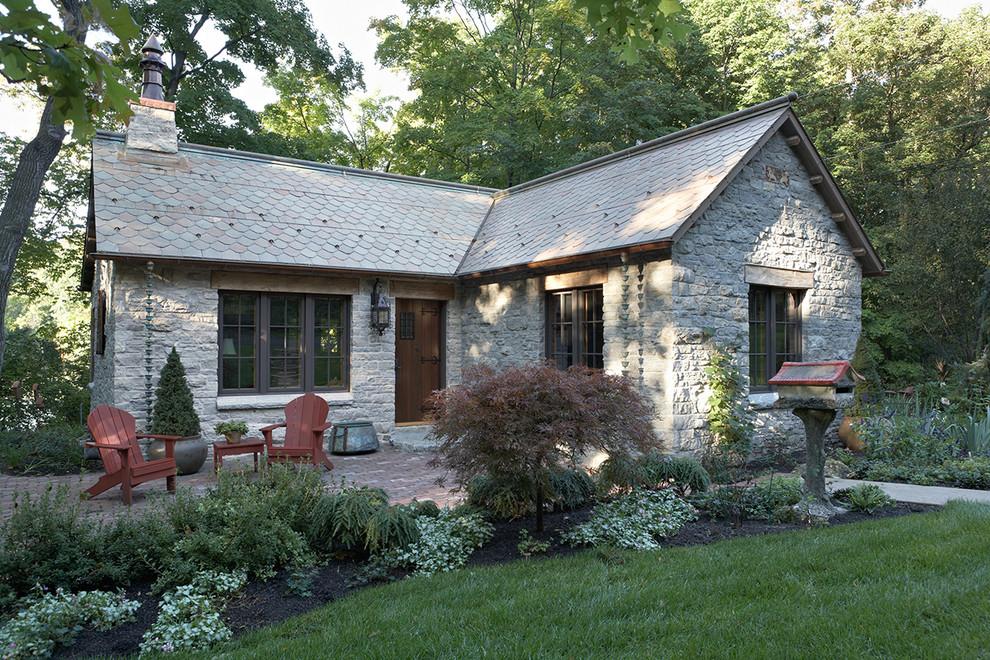 Mountain style stone exterior home photo in Minneapolis