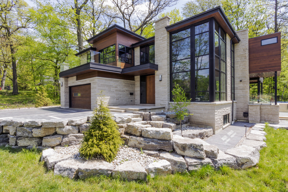 Contemporary two-story mixed siding exterior home idea in Toronto