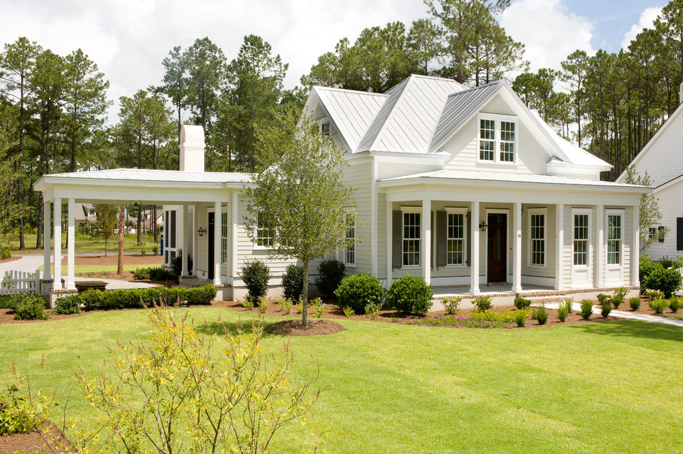 Example of a small classic two-story exterior home design in Charleston