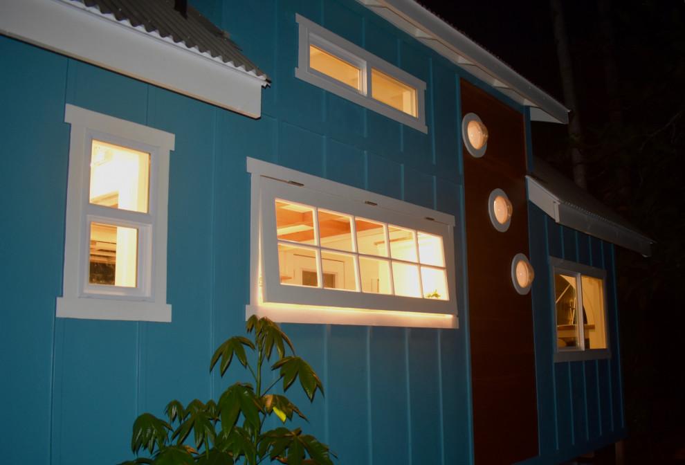 the oasis tiny home round windows paradise tiny homes llc img~4931c2ec0e754bac 9 7159 1 34c7910