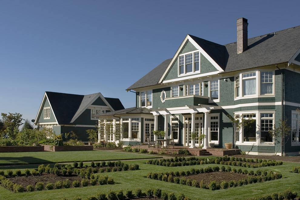 Example of a large ornate three-story wood exterior home design in Portland