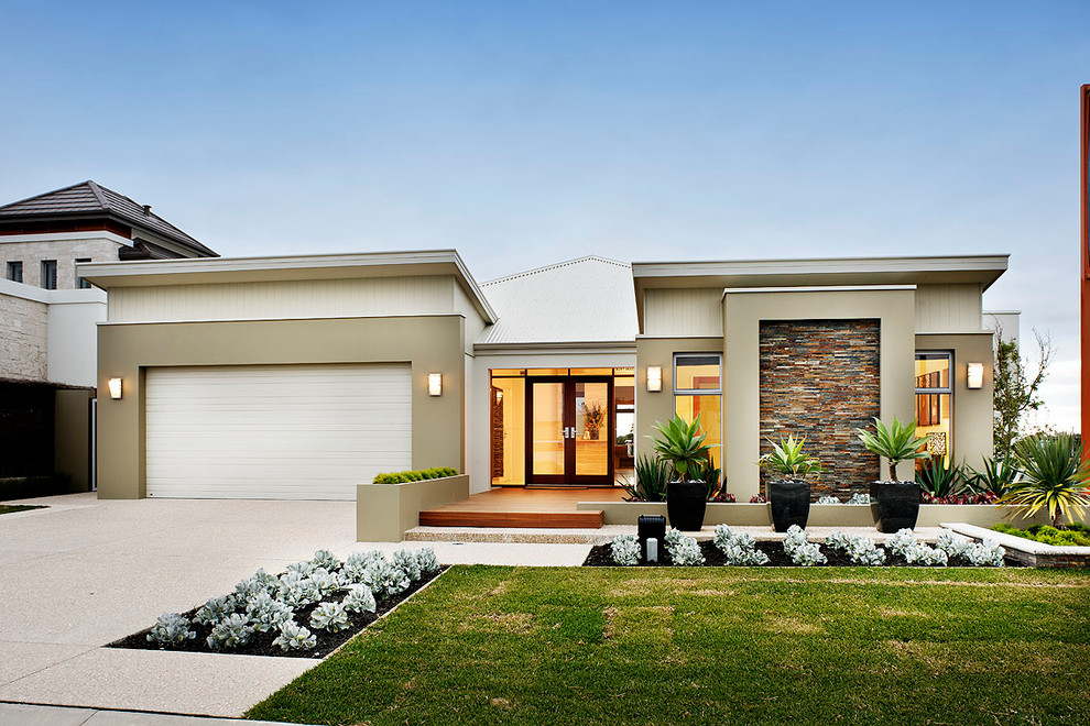 Example of a trendy beige one-story exterior home design in Perth with a mixed material roof