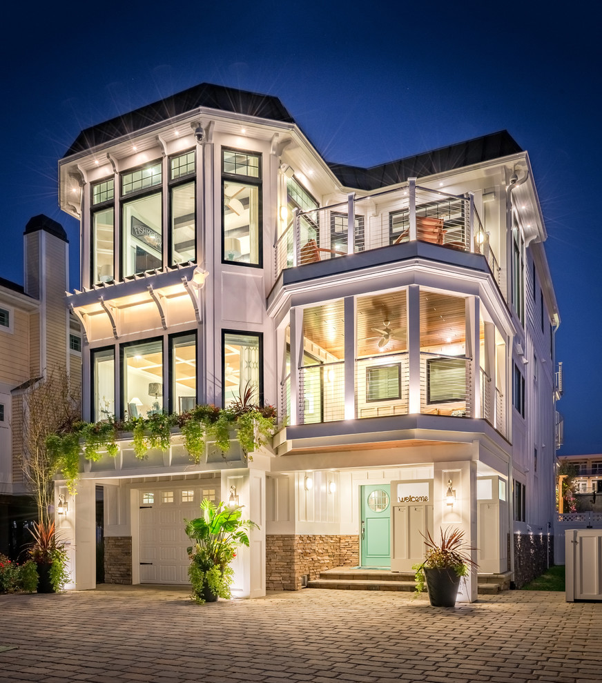 Inspiration for a coastal white three-story exterior home remodel in Other