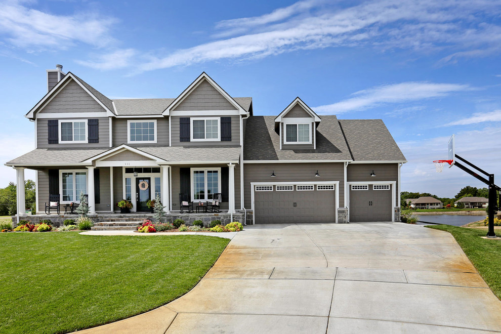 Large arts and crafts gray two-story concrete fiberboard exterior home photo in Wichita