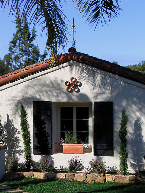Thick wooden shutters on a small spanish style home in for Tiny house santa barbara